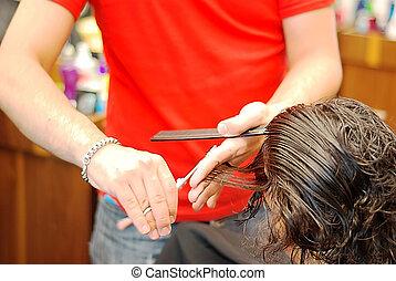 Hair dressing - Hands holding scissors cutting hair