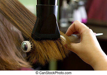 Hair dressing process - Close-up view of hair dressing ...