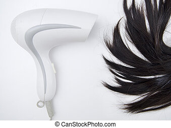Hair Dryer blowing on woman hair.