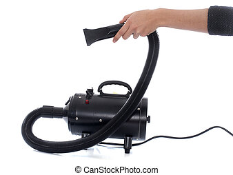 Hair dryer for dog in front of white background
