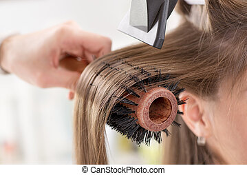 Hair drying. - Drying long brown hair with hair dryer and...