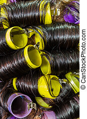 Hair during hair dressing with curler. - Close up of hair ...