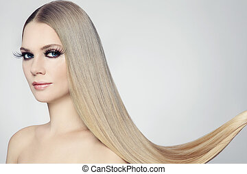 Hair extension - Young beautiful woman with long blond hair...