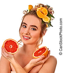 Hair hydrating mask from fresh fruits on woman head.