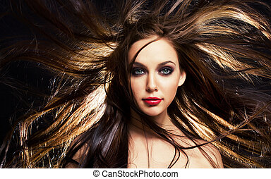 hair in motion - close up portrait of young brunette woman,...