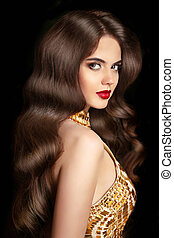 Beautiful brunette girl with long wavy shiny hairstyle