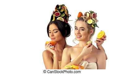 Hair mask from fresh fruits concept. Two women enjoy by ...
