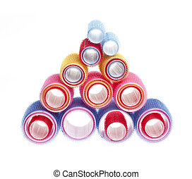 Hair rollers on white - Colorful hair rollers stacked in...