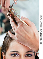 hair salon - Close up of young woman having her hair being ...