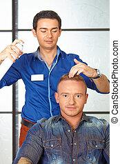 Hair salon. Man haircut. Spraying.