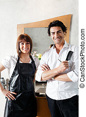 hair salon - portrait of two hairstylists looking at camera