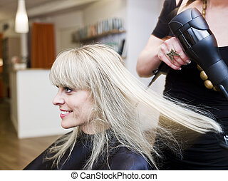 Hair Salon situation - Blond woman at the Hair Salon