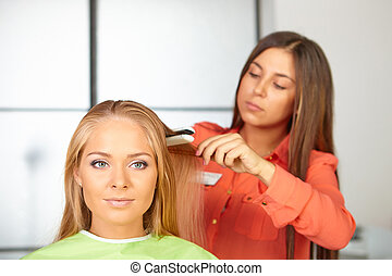 Hair salon. Womens haircut. Use of straightener. -...