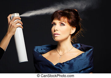 Hair spray, beauty woman over black background.