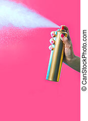 Hair spray - Photo of hair lacquer in female?s hand spraying...
