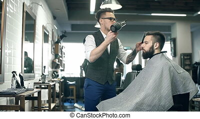 Hair Styling - Close up of barber blow drying hair of the ...