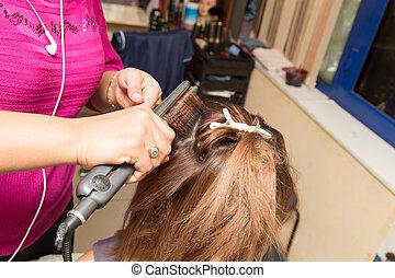 Hair styling in a beauty salon