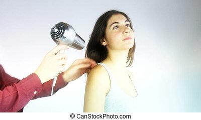 Hair stylist dry long hair - hairdresser drying very long...