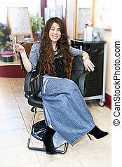Hair stylist in salon