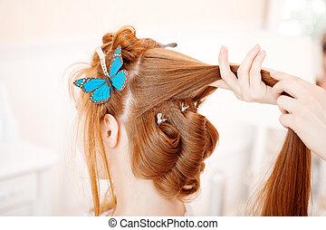 Hair stylist makes the bride before the wedding - Hair...
