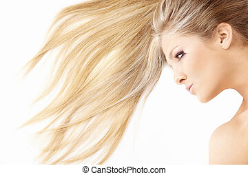 Close up of hair and face of beautiful lying blonde, isolated