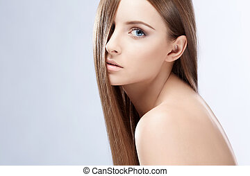 Young girl with hair on white background