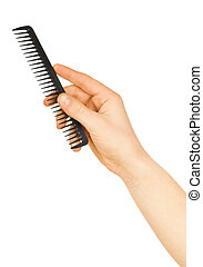 hairbrush in the hand isolated on white