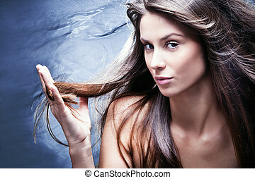 haircare - young brunette woman with nourished long hair,...