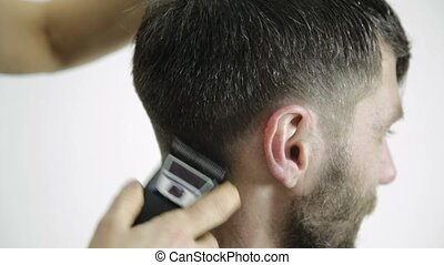 Haircut at barbershop. hairdresser uses scissors for cutting...