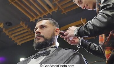 Haircut men Barbershop. Men's Hairdressers; barbers. Barber cuts the client machine for haircuts. bottom view.