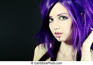 haircut - Portrait of a punk girl. Over black background.