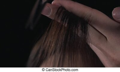 Haircut with scissors close up