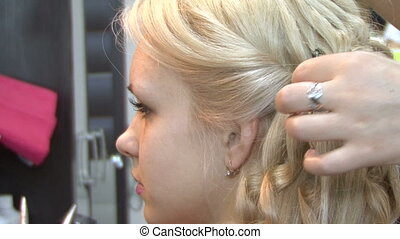 Hairdo - Beautiful blonde hair make styling.