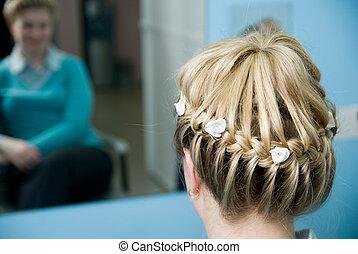 Hairdress a plait in salon