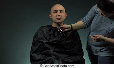 Hairdresser and bald man - Footage of shaving man's head on...