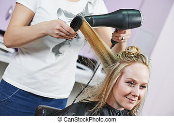 hairdresser at work. Dryeing hair
