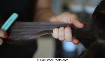 Hairdresser at work - Hairdresser working with dark hair...