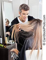 Hairdresser Attending Customer In Hair Salon