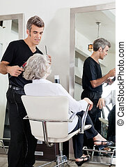 Hairdresser Attending Woman At Salon