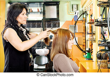 combing customer's hair