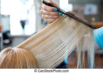 Hairdresser Combing Female Customer's Hair