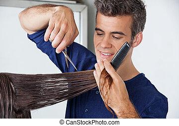 Hairdresser Cutting Client's Hair - Male hairdresser cutting...