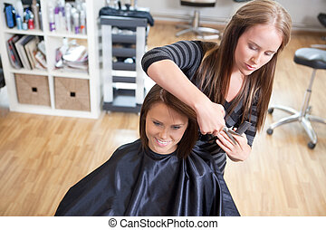 Hairdresser Cutting Client's Hair