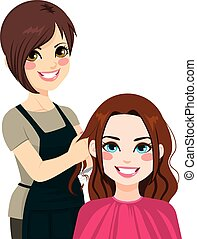 Professional hairdresser working cutting long curly hair to beautiful brunette girl
