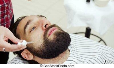 Hairdresser gets oil on beard