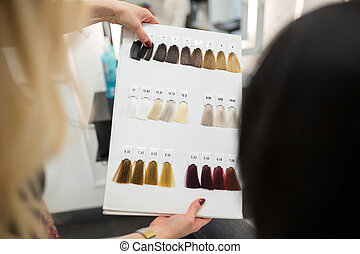 Hairdresser holding hair color palette
