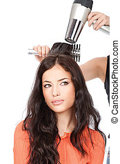hairdresser is drain a long black hair - hairdresser is...