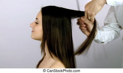 hairdresser layering long hair - beautiful female model...