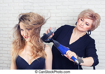 Hairdresser makes styling
