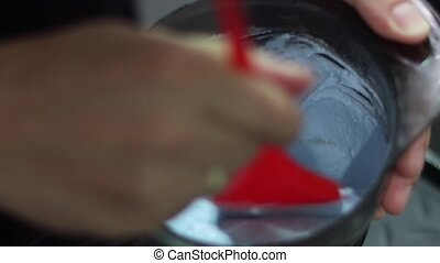 Hairdresser mixing hair dye in bowl in hair salon. hair dye...
